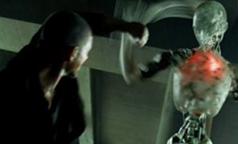 Robot fighting a man.