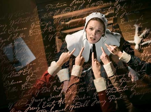 """Accusing fingers pointing at a colonist woman and condemned """"witch"""" at the Salem witch trials."""